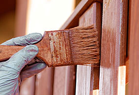painter painting a fence partition