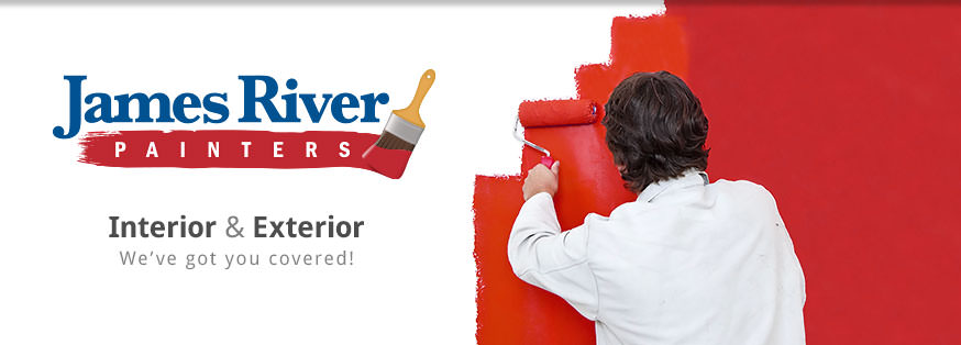 Painter painting a wall with red paint